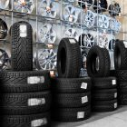Car tyres and alloy wheels in a shop