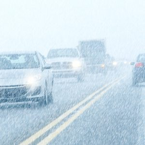 Cars driving in Snow storm