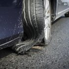 Damaged tyre after explosion on high speed on highway