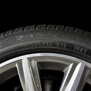 Close up of the number code on the sidewall of car tyre with alloy wheel, Tyre Sidewall Markings.