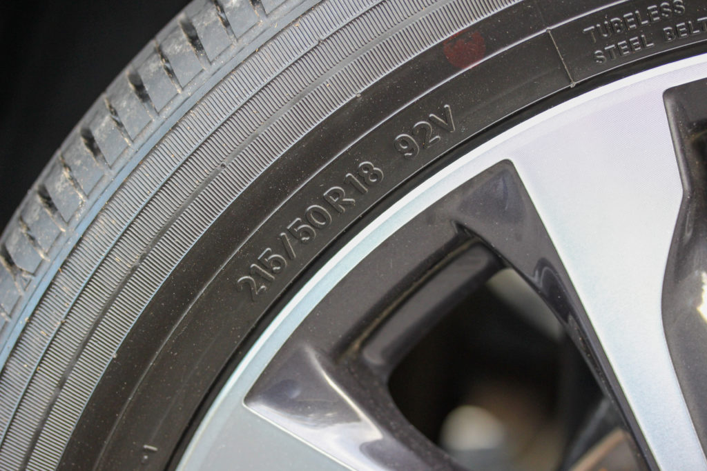 A car sidewall showing the tyre identification numbers